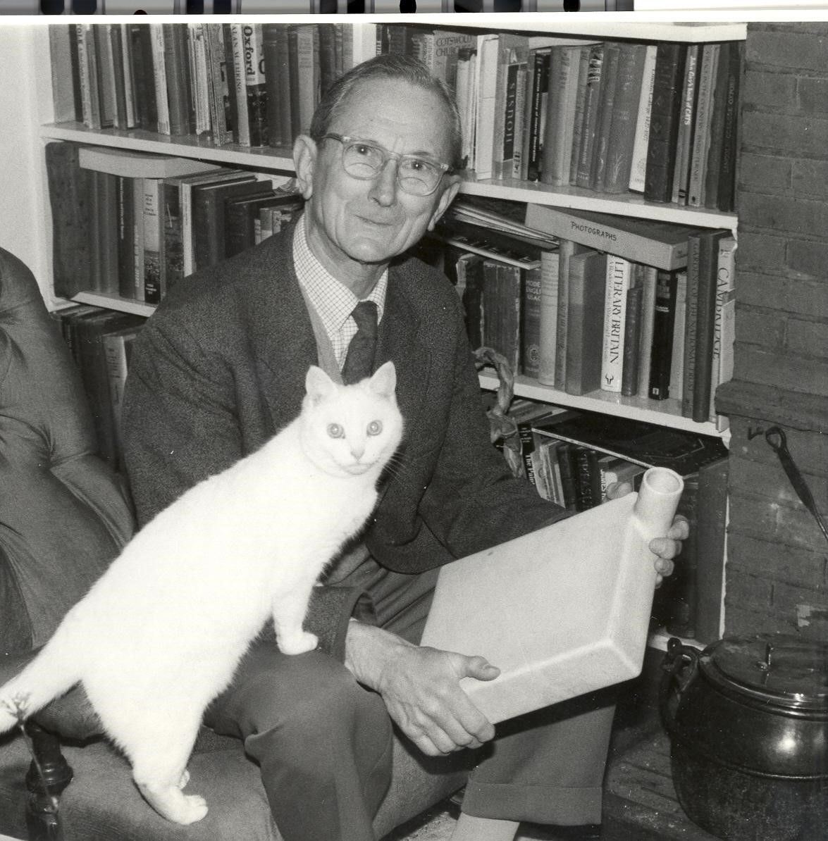 Norman Heatley (and cat) with one of his original ceramic penicillin culture vessels
