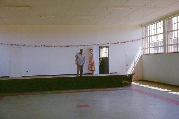 Jimmy Betts and Ruth Khama inside the community centre. Photo credit: Hugh McIntosh. (Oxfam Archive, Bodleian Libraries)