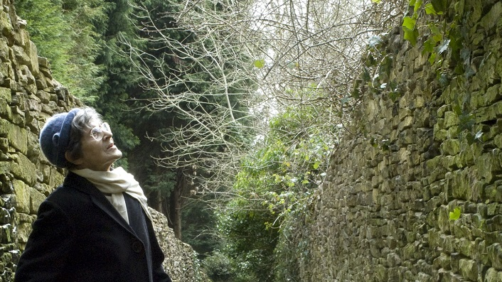 Jenny Joseph standing in a lane Minchinhampton, Gloucestershire, 2009 © Georgie Brocklehurst