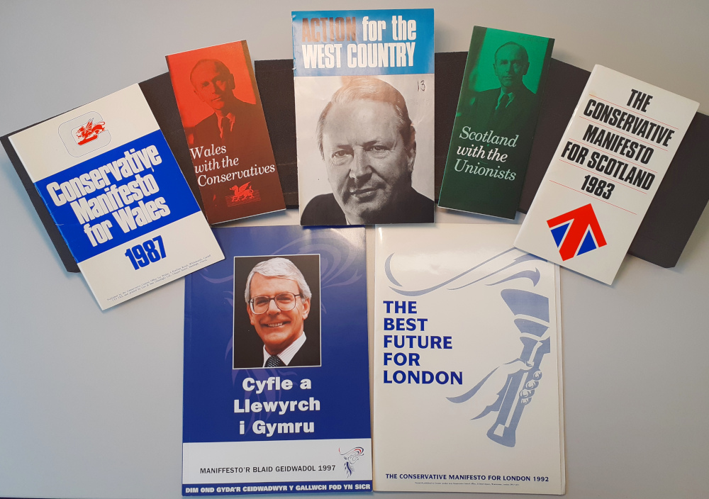 Pictured: a selection of Conservative Party manifesto variations produced for voters in Scotland, Wales and the English regions.