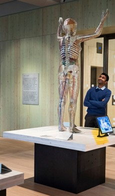 Photograph of Miten at the Being Human exhibition at Wellcome Collection, 2019.