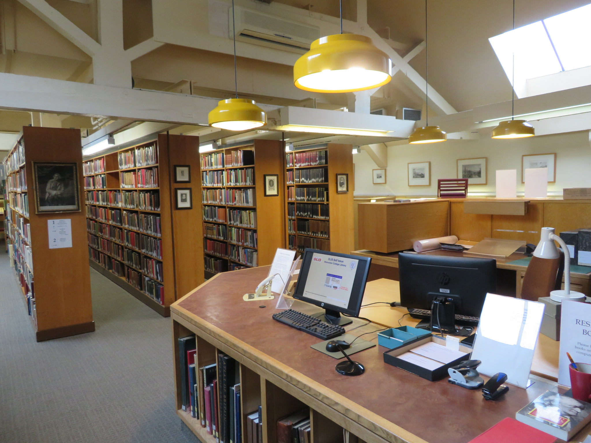 A photograph of the issue desk in Worcester College's more modern upper library.