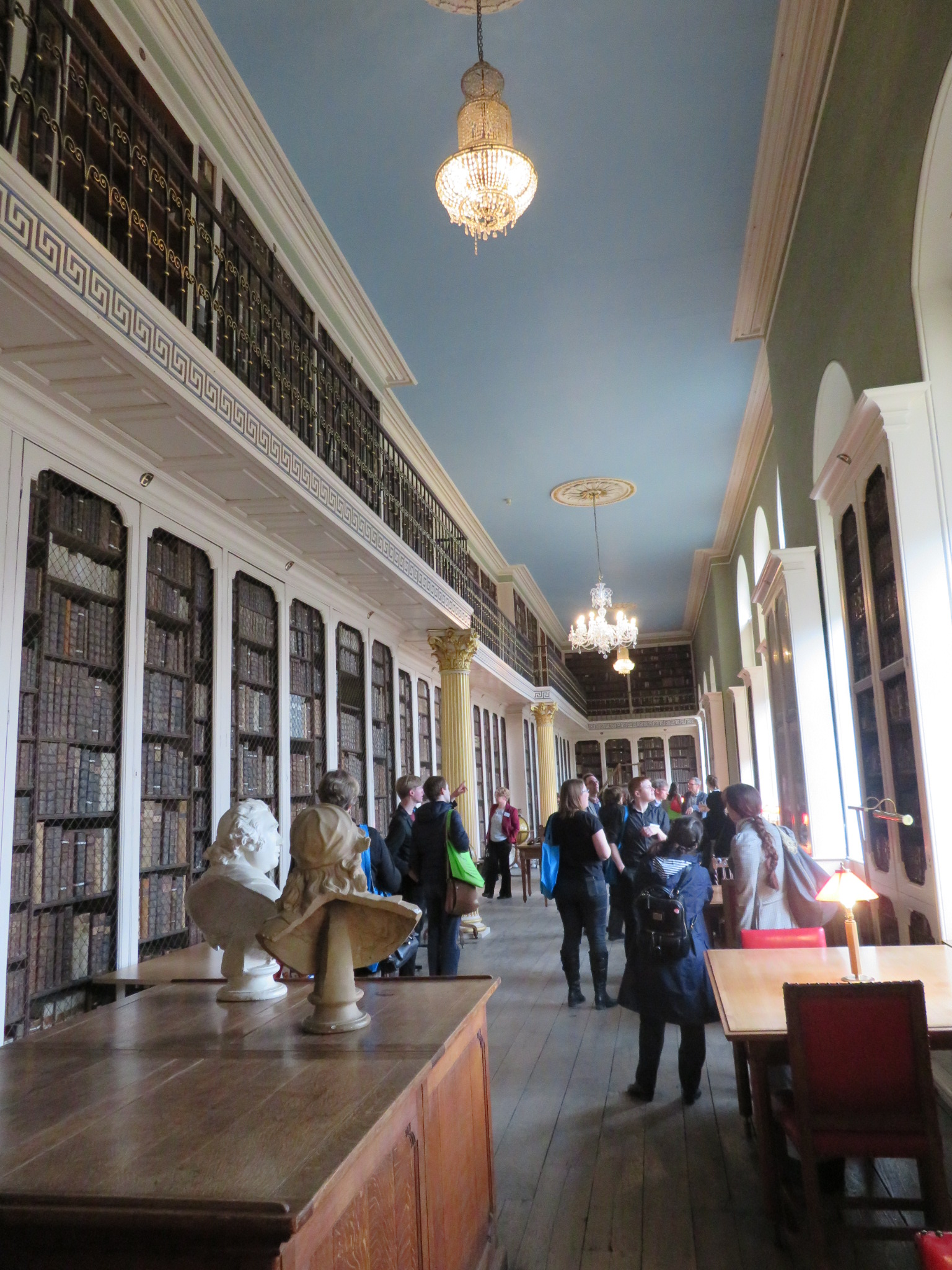 A photograph of the early-modern lower library of Worcester College, including busts and galleries.