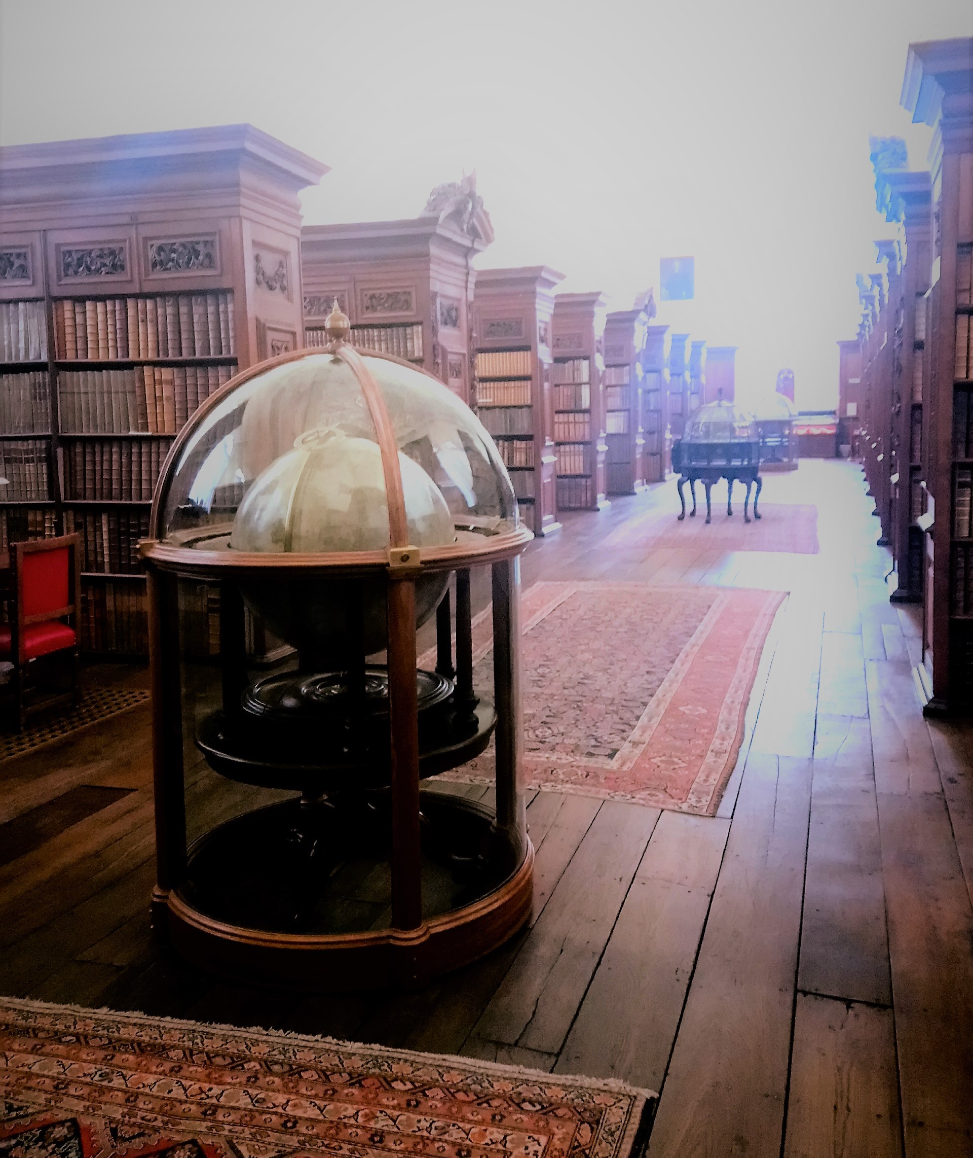 A photograph of the Queen's College Library's Upper Library with orreries in the central passage.