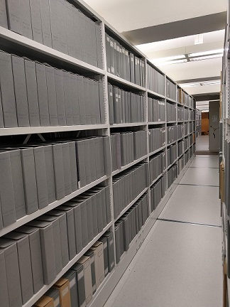 Rows of shelving which are part of the Official Papers collection