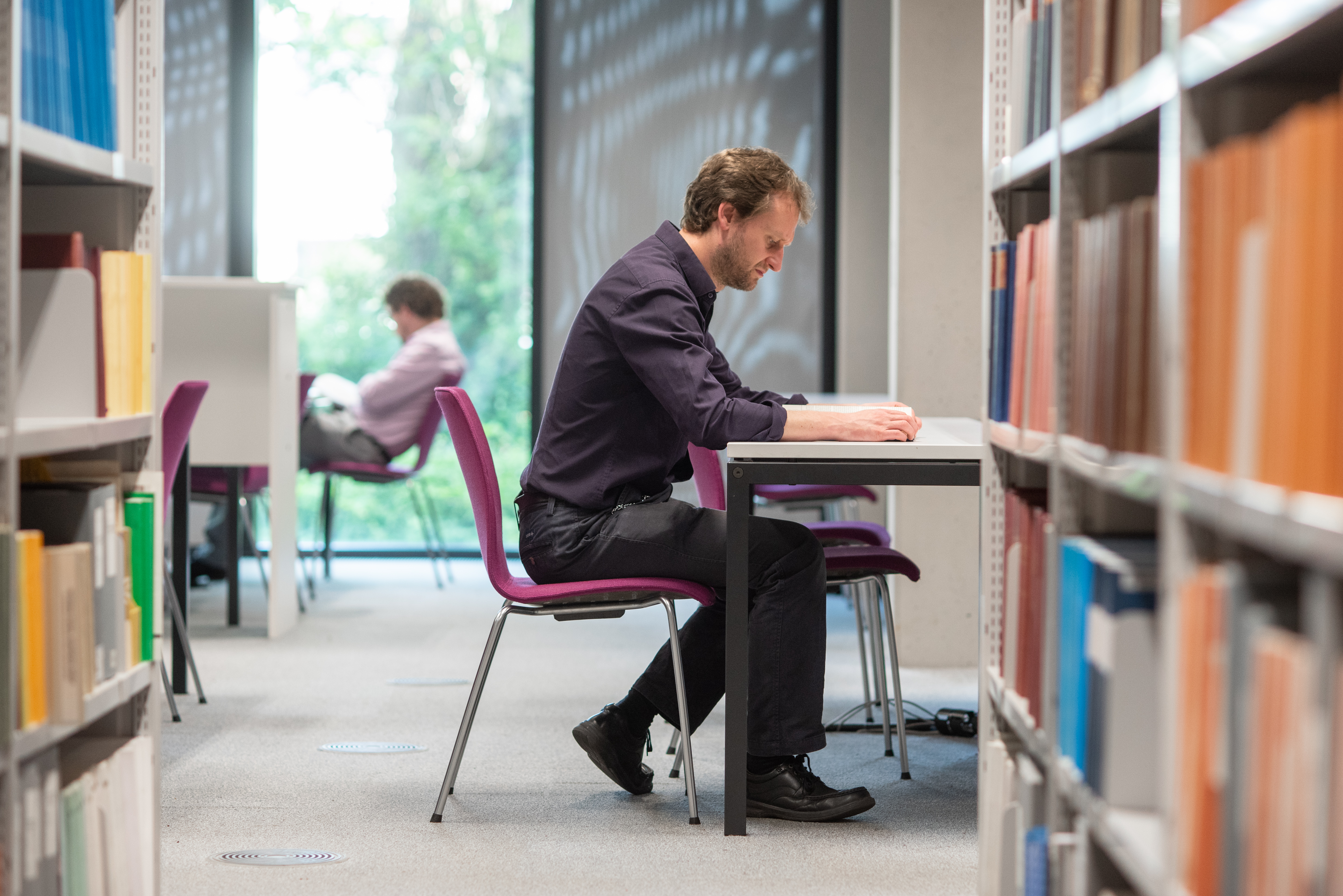 Student sat studying at a desk in the SSL