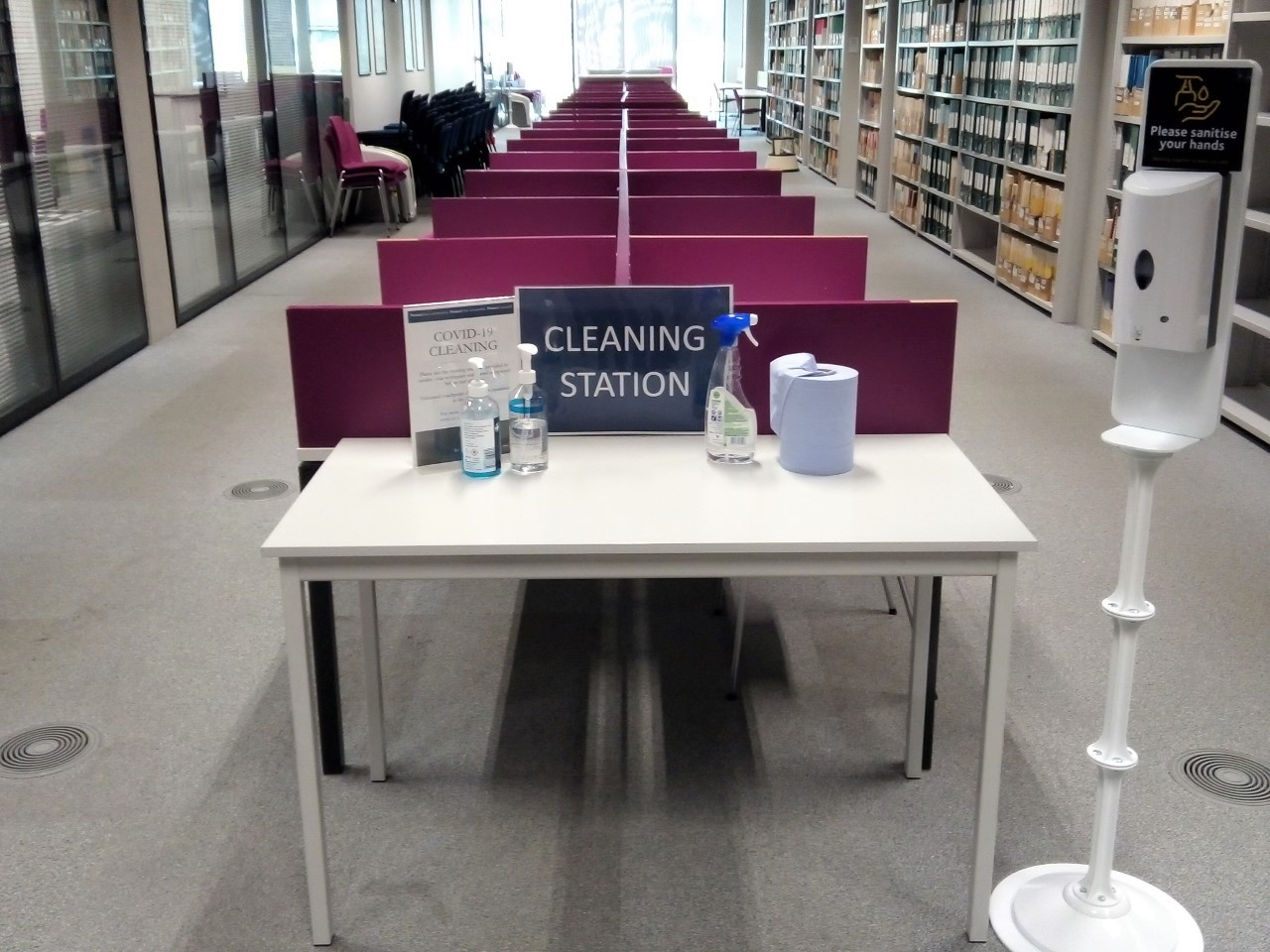 Photo of a cleaning station. A table which has cleaning supplies on it for use in the library.