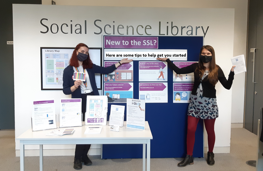 2 Library staff standing in the SSL entrance area in front of a noticeboard saying New to the SSL? Here are some tips to help get you started.
