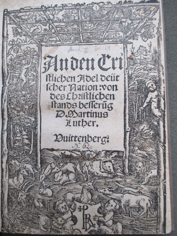 Allegorical title page showing the vine (Christ) providing a protective shelter over the idyllic society beneath, where lions and bears are living alongside rabbits, deer and lambs. Luther's text calls on Christian nobility to take responsibility for building a Christian society.