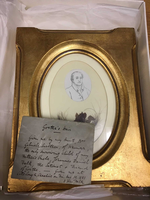 Goethe's hair, framed with sketched portrait and violet. The English envelope features on top.