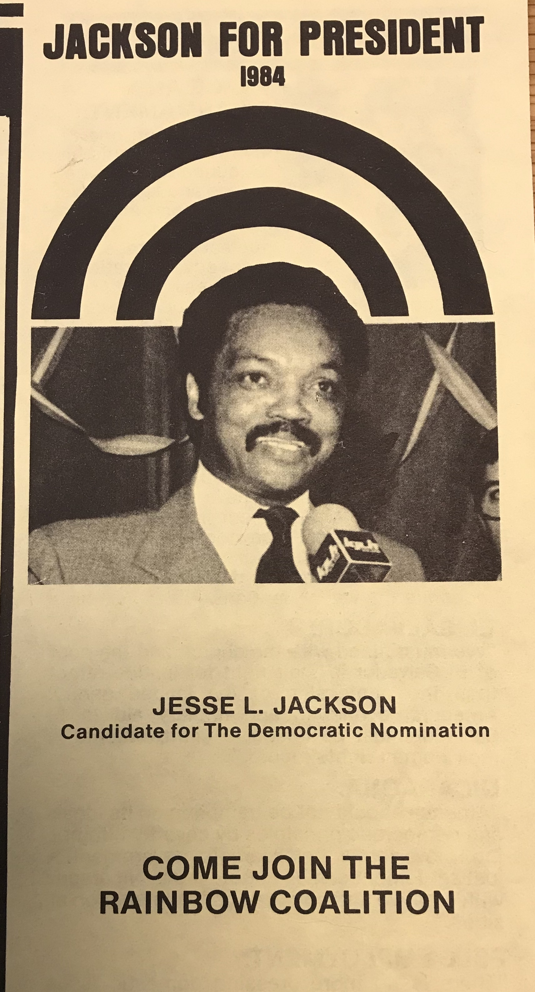 A leaflet showing Jesse Jackson, on yellow paper. There are rainbow bands behind the image.