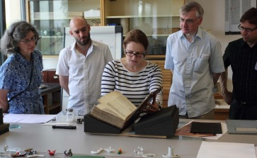 Nicole Gilroy shows the First Folio to visitors Francesca Heaney, Steve Rodgers, Richard McCabe and Tim Kirtley