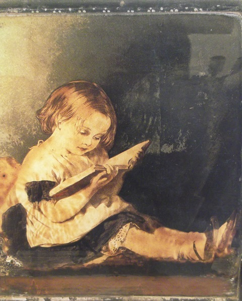 Little girl reading, from a coal scuttle of about 1860 in the possession of Mrs. Iona Opie