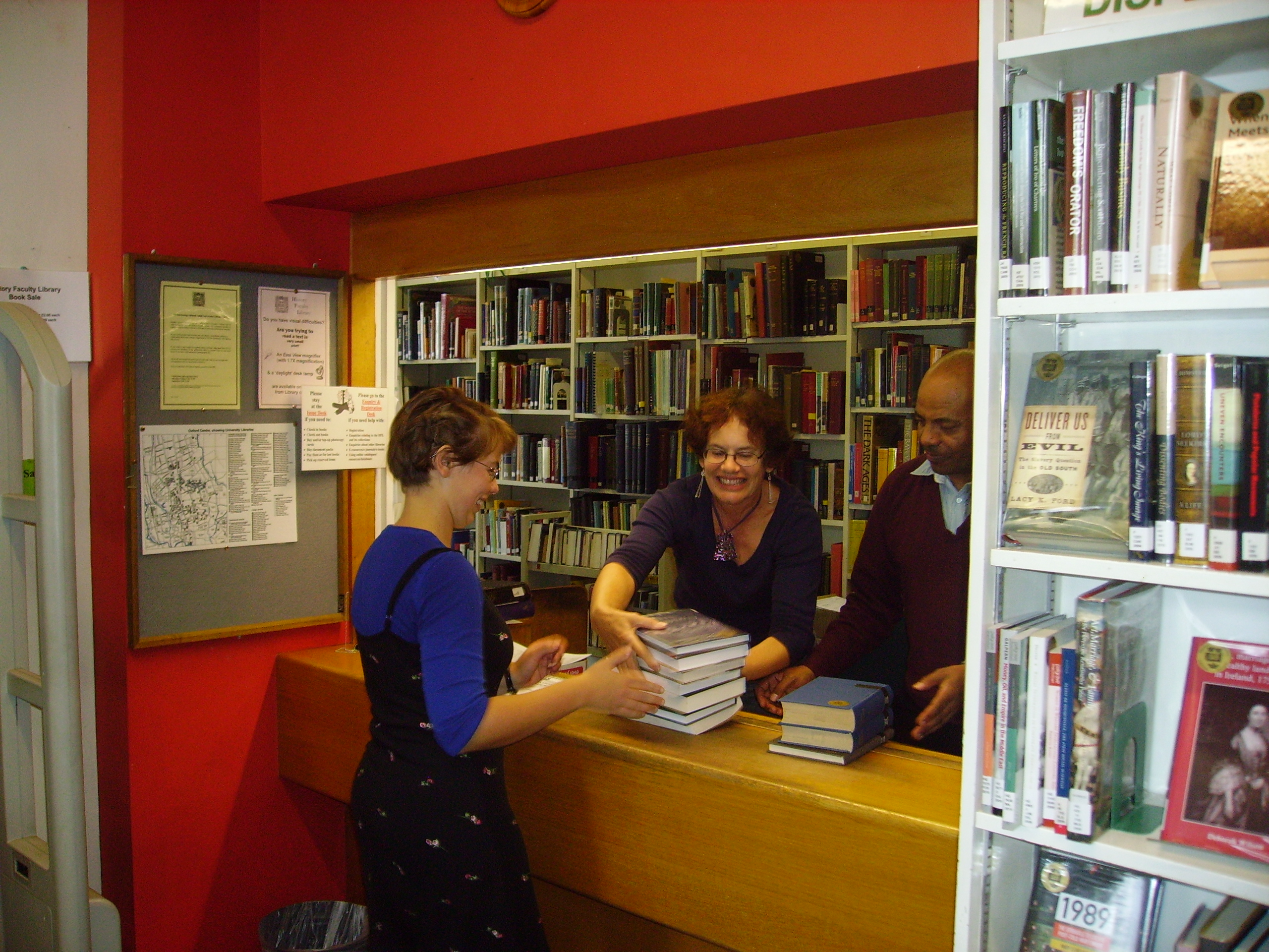 Picture of reader borrowing books at issue desk