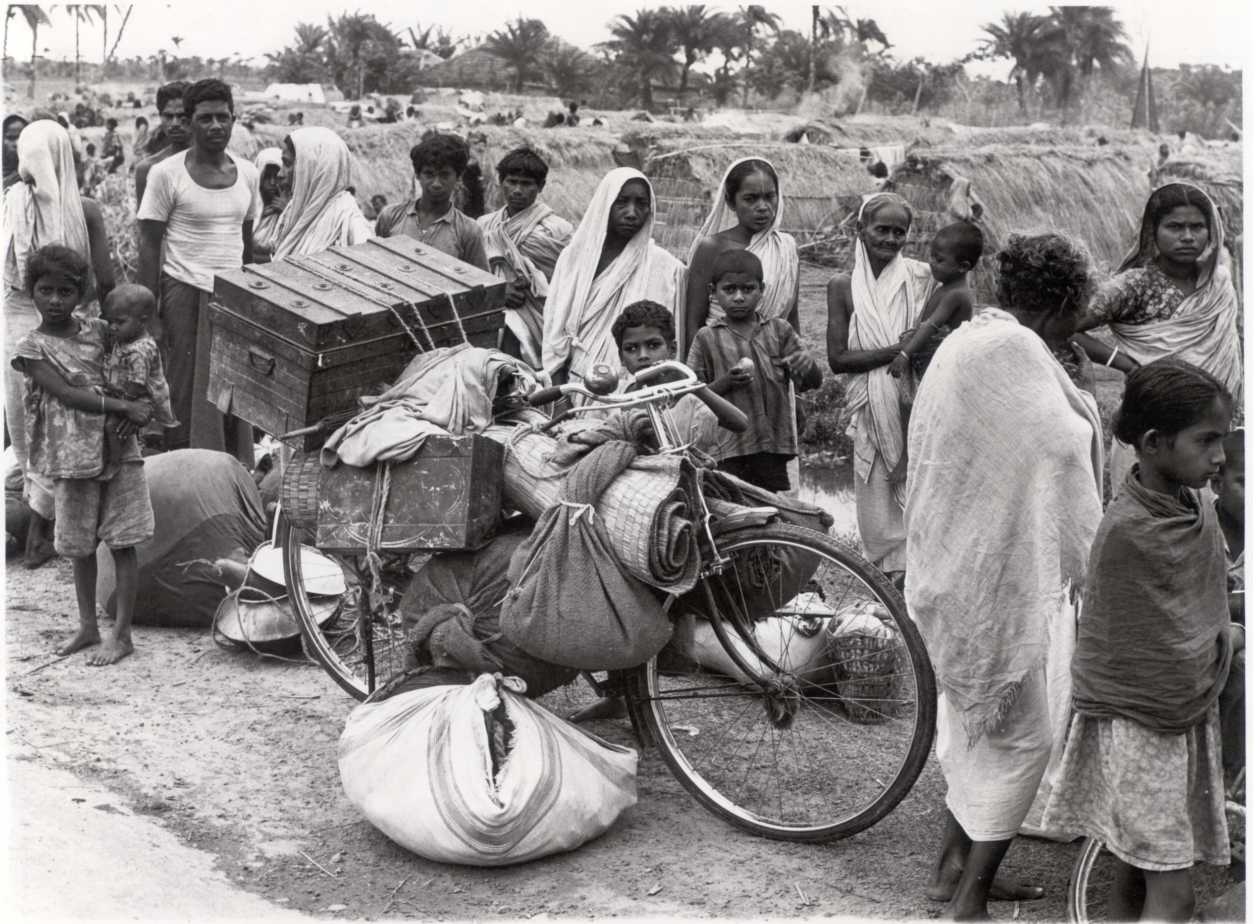 Refugees from the civil war in East Pakistan (later Bangladesh) in India, 1971. In response, Oxfam launched a health programme serving 500,000 people and, on the creation of Bangladesh the following year, its largest country rehabilitation and development programme to that date. Photo credit: Alan Leather / Oxfam (Oxfam Archive, Bodleian Library)