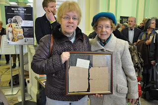 Picture of two women holding letters