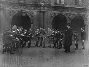 Belgian boys during their play hour in the quadrant of St John's College, Oxford University, where they are being educated by Belgian schoolmasters. By Nicholls, Horace (Photographer) [Public domain], via Wikimedia Commons